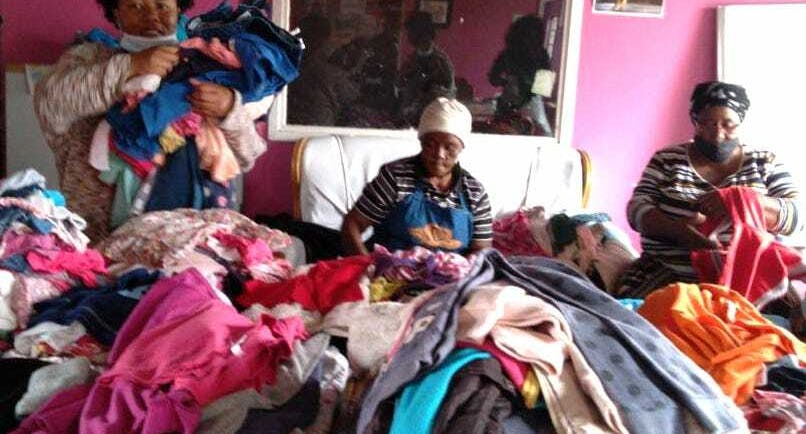 Women sorting clothes for ditribution